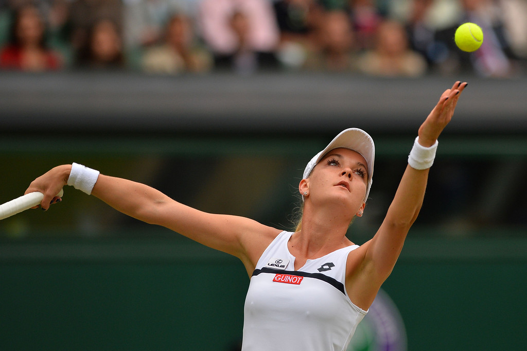 . Poland\'s Agnieszka Radwanska serves against China\'s Li Na during their women\'s singles quarter-final match on day eight of the 2013 Wimbledon Championships tennis tournament at the All England Club in Wimbledon, southwest London, on July 2, 2013. BEN STANSALL/AFP/Getty Images