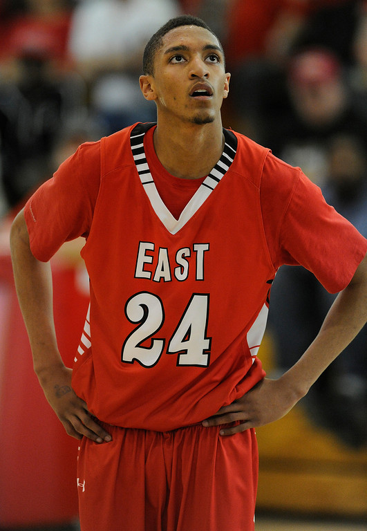 . DENVER, CO. - FEBRUARY 16: Angels junior Dominique Collier watched a free-throw late in the second quarter. The Denver East High School boy\'s basketball team defeated George Washington 82-20 Saturday afternoon, February 16, 2013.  (Photo By Karl Gehring/The Denver Post)
