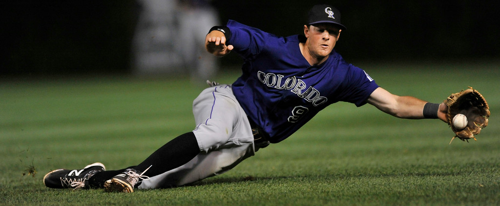 . Colorado Rockies second baseman D.J. LeMahieu fields a single hit by Chicago Cubs\' Luis Valbuena during the sixth inning of a baseball game in Chicago, Wednesday, July 30, 2014. (AP Photo/Paul Beaty)