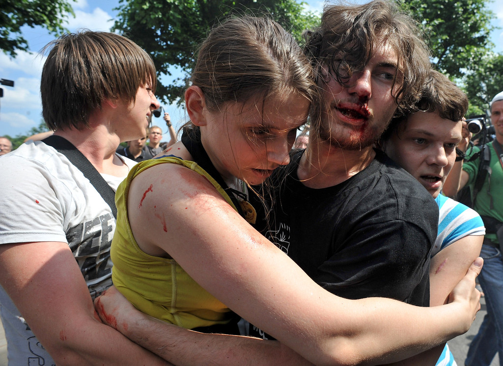 . Gay rights activists embrace each other after clashes with anti-gay demonstrators during a gay pride event in St. Petersburg on June 29, 2013. Russian police arrested dozens of people on Saturday after clashes erupted in the city of Saint Petersburg between pro- and anti-gay demonstrators. OLGA MALTSEVA/AFP/Getty Images
