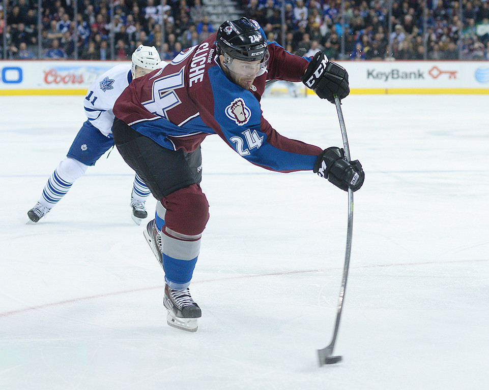 . DENVER, CO. - JANUARY 21:  Avalanche center Marc-Andre Cliche (24) fired a shot on net in the third period. The Toronto Maple Leafs defeated the Colorado Avalanche 5-2 Tuesday night, January 21, 2014 at the Pepsi Center. Photo By Karl Gehring/The Denver Post