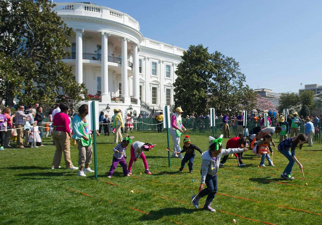 . Children race to roll eggs as they participate in the White House Easter Egg Roll on the South Lawn of the White House in Washington, DC, April 1, 2013. US President Barack Obama hosts the annual event, featuring live music, sports courts, cooking stations, storytelling and Easter egg rolling. AFP PHOTO / Saul LOEB/AFP/Getty Images