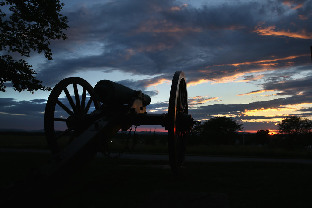 . GETTYSBURG, PA - JUNE 28:  A canon aims from the Gettysburg National Military Park ahead of the 150th anniversary of the Battle of Gettysburg on June 28, 2013 in Gettysburg, Pennsylvania. Some 8,000 re-enactors are participating events marking the July 1-3, 1863 Battle of Gettysburg, considered the turning point in favor of the Union in the American Civil War. Union and Confederate armies suffered a total of 46,000-51,000 casualties in the battle, the largest number in the war. (Photo by John Moore/Getty Images)