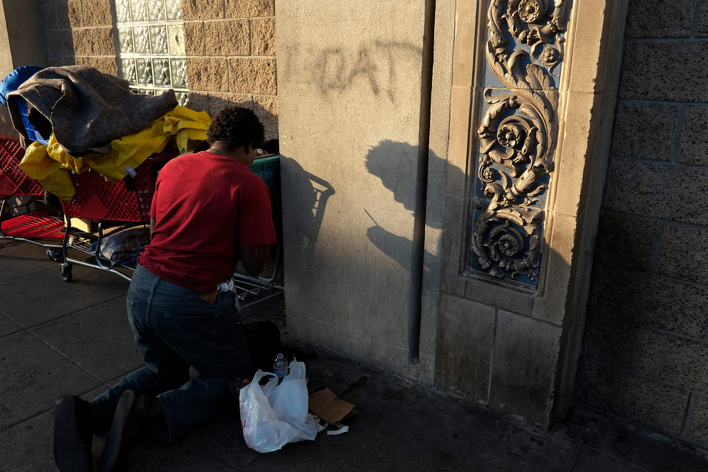 . A 25-year-old homeless drug addict prepares a needle to inject himself with heroin in the Skid Row area of Los Angeles, Thursday, April 25, 2013. It\'s not a rare scene on Skid Row to spot addicts using drugs in the open, even when police patrol the area. (AP Photo/Jae C. Hong)