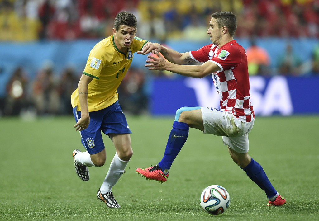 . Brazil\'s midfielder Oscar (L) and Croatia\'s defender Sime Vrsaljko vie for the ball during a Group A football match between Brazil and Croatia at the Corinthians Arena in Sao Paulo during the 2014 FIFA World Cup on June 12, 2014. AFP PHOTO / DIMITAR DILKOFF/AFP/Getty Images