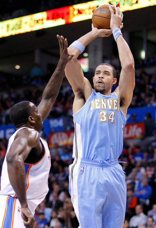 . Denver Nuggets Center JaVale McGee (34) shoots against Oklahoma City Thunder center Kendrick Perkins (5) during the first quarter of an NBA basketball game in Oklahoma City, Wednesday, Jan. 16, 2013.  (AP Photo/Alonzo Adams)