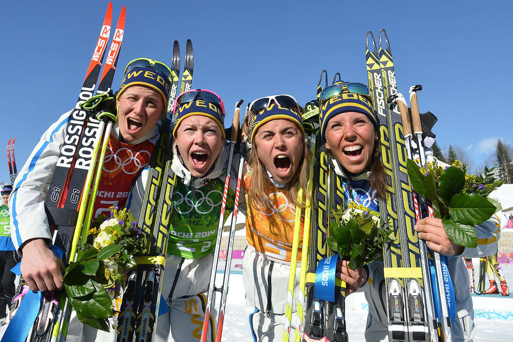 . (L-R) Sweden\'s Ida Ingemarsdotter, Emma Wiken, Anna Haag and Charlotte Kalla celebrate their Gold Medal during the Women\'s Cross-Country Skiing 4x5km Relay Flower Ceremony at the Laura Cross-Country Ski and Biathlon Center during the Sochi Winter Olympics on February 15, 2014, in Rosa Khutor near Sochi.    ALBERTO PIZZOLI/AFP/Getty Images
