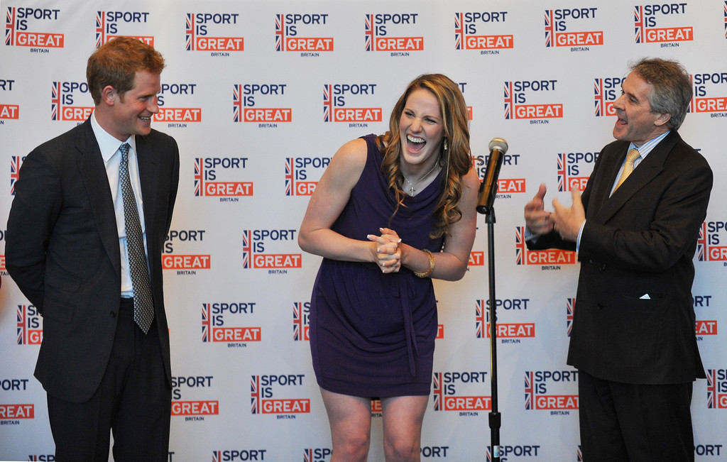 . SEDALIA, CO. - MAY 10 : Prince Harry, left, and British Ambassador Peter Westmacott, right, celebrate 18th birthday of Gold medal swimmer Missy Franklin, center, during the reception at Club House of Sanctuary Golf Course in Sedalia, Colorado. May 10, 2013. (Photo By Hyoung Chang/The Denver Post)