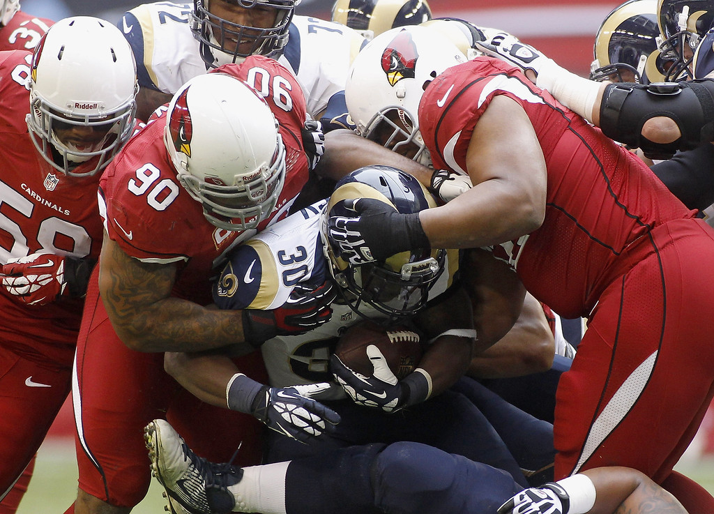. Running back Zac Stacy #30 of the St Louis Rams is stopped for no gain by Darnell Dockett #90 and Dan Williams #92 (R) of the Arizona Cardinals during the first quarter of their NFL football game at University of Phoenix Stadium on December 8, 2013 in Glendale, Arizona.  (Photo by Ralph Freso/Getty Images)
