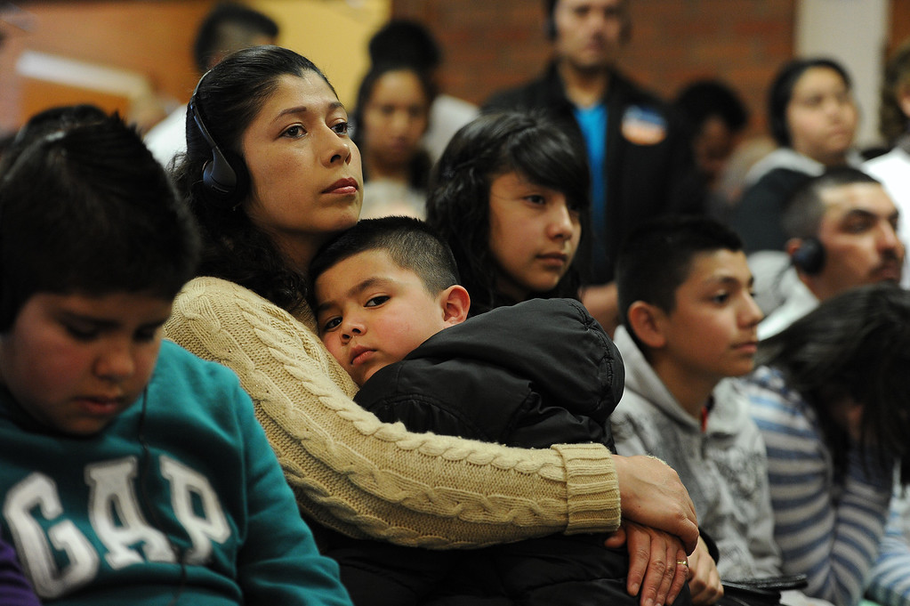 . AURORA, CO- FEBRUARY 9: Maria Tarango holds her son Oscar Tarango, 4, during the meeting that was filled to capacity in St. Therese Catholic Church. TOGETHER COLORADO held a public meeting  to talk about the United States immigration policies at St. Therese Catholic Church, 1243 Kingston Street in Aurora, Co  on February 9th, 2013.   Colorado State Senator Michael Bennet, and Colorado Representatives Mike Coffman and Jared Polis attended and spoke at the meeting.  The organization wanted to tell the state\'s representatives why they want a road map to citizenship for 11 million aspiring Americans.  More than 800 faith and community leaders packed the small church in Aurora. (Photo By Helen H. Richardson/ The Denver Post)