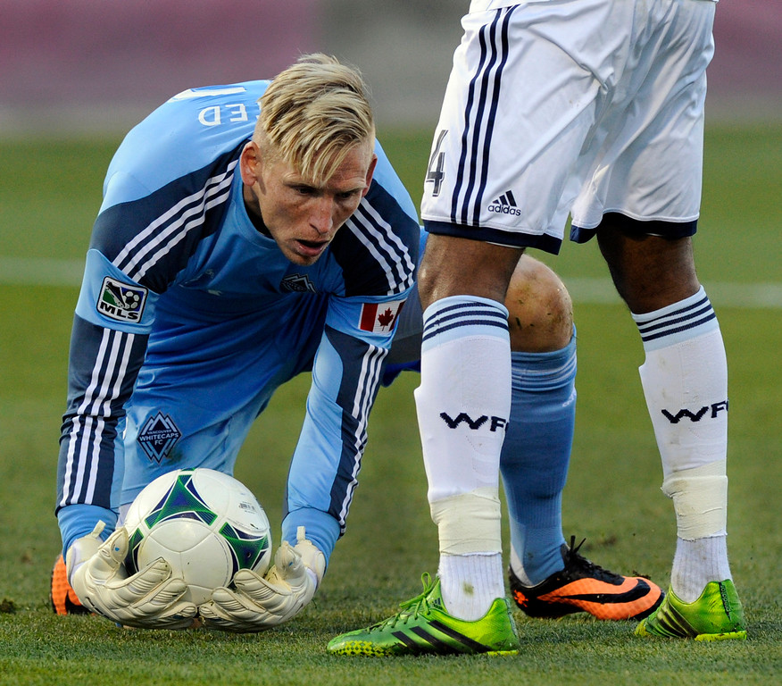 . COMMERCE CITY, CO. - OCTOBER 19: Vancouver goalkeeper David Ousted made a save in the second half. The Colorado Rapids defeated the Vancouver Whitecaps 3-2 at Dick\'s Sporting Goods Park Saturday, October 19, 2013. Photo By Karl Gehring/The Denver Post