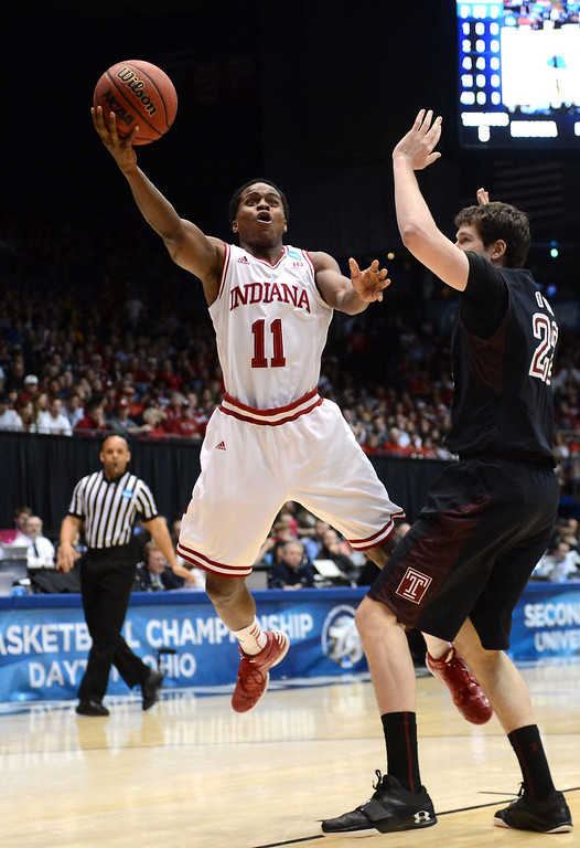 . Yogi Ferrell #11 of the Indiana Hoosiers drives to the basket against Jake O\'Brien #22 of the Temple Owls in the first half during the third round of the 2013 NCAA Men\'s Basketball Tournament at UD Arena on March 24, 2013 in Dayton, Ohio.  (Photo by Jason Miller/Getty Images)