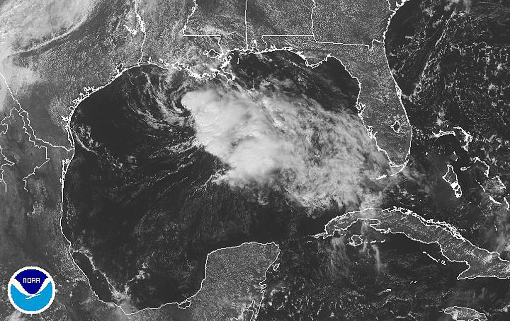 . This image obtained from the National Oceanic and Atmospheric Administration (NOAA) shows Tropical Storm Karen in the Gulf of Mexico on October 5, 2013. Karen, swirling offshore in the Gulf of Mexico, was on track to make landfall late Saturday in the US state of Louisiana, forecasters said. While weakening overnight, the storm is still expected to bring rain and some coastal flooding as it moves toward Mississippi and Alabama, according to the National Hurricane Center. At 1800 GMT, Karen was located about 130 miles (205 kilometers) south-southwest of Morgan City, Louisiana, packing maximum sustained winds of 40 miles per hour. Hurricane watches were canceled overnight, but a tropical storm warning was in effect for an area that included Morgan City, located about 70 miles west of New Orleans.      AFP PHOTO/NOAA-/AFP/Getty Images