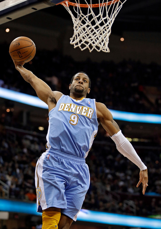 . Denver Nuggets\' Andre Iguodala soars in for a dunk against the Cleveland Cavaliers in the first quarter of an NBA basketball game Saturday, Feb. 9, 2013, in Cleveland. (AP Photo/Mark Duncan)