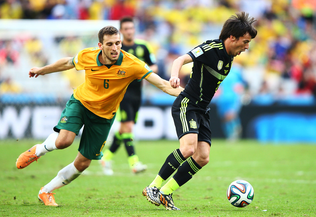 . David Silva of Spain controls the ball against Matthew Spiranovic of Australia during the 2014 FIFA World Cup Brazil Group B match between Australia and Spain at Arena da Baixada on June 23, 2014 in Curitiba, Brazil.  (Photo by Ian Walton/Getty Images)
