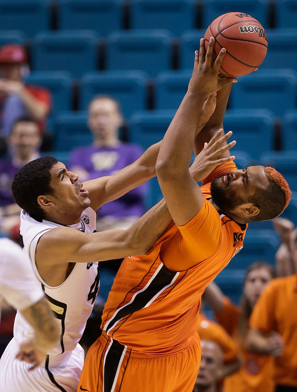 . Oregon State\'s Joe Burton, right, pulls down a rebound against Colorado\'s Josh Scott in the second half during a Pac-12 tournament NCAA college basketball game on Wednesday, March 13, 2013, in Las Vegas. Colorado won 74-68. (AP Photo/Julie Jacobson)