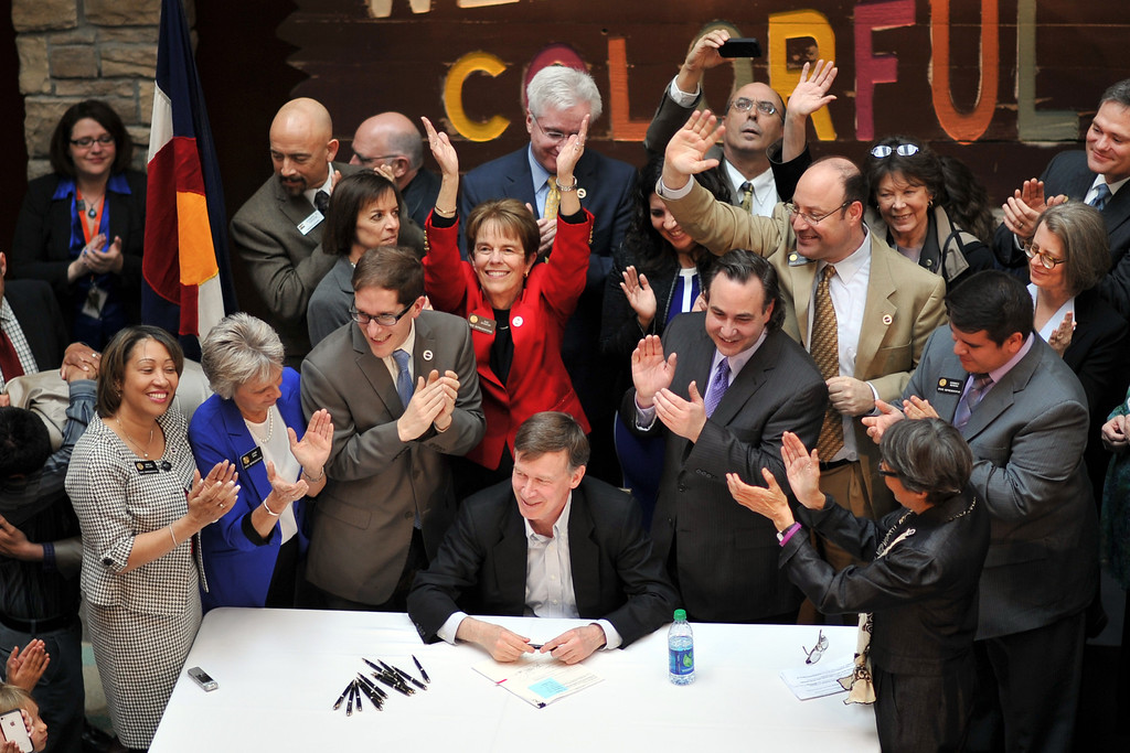 . DENVER, CO. - MARCH 21: Colorado Gov. John Hickenlooper, bottom, signed Senate Bill 11 legalizing civil unions at a packed History Colorado Center on Thursday,  Denver, Colorado. March 21, 2013. (Photo By Hyoung Chang/The Denver Post)