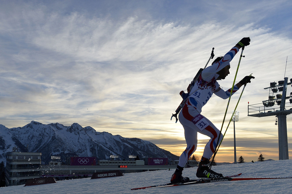 . France\'s Martin Fourcade competes to win gold in the Men\'s Biathlon 20 km Individual at the Laura Cross-Country Ski and Biathlon Center during the Sochi Winter Olympics on February 13, 2014 in Rosa Khutor near Sochi.    ODD ANDERSEN/AFP/Getty Images
