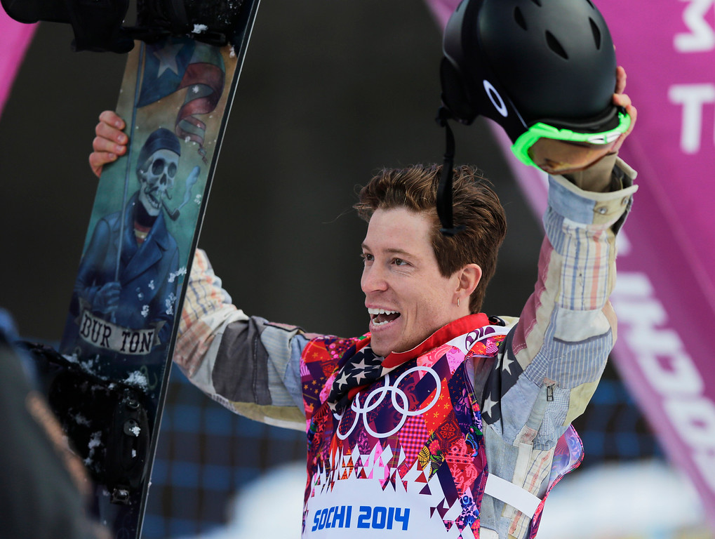 . Shaun White of the United States waves to the crowd after a run during the men\'s snowboard halfpipe qualifying at the Rosa Khutor Extreme Park, at the 2014 Winter Olympics, Tuesday, Feb. 11, 2014, in Krasnaya Polyana, Russia. (AP Photo/Andy Wong)