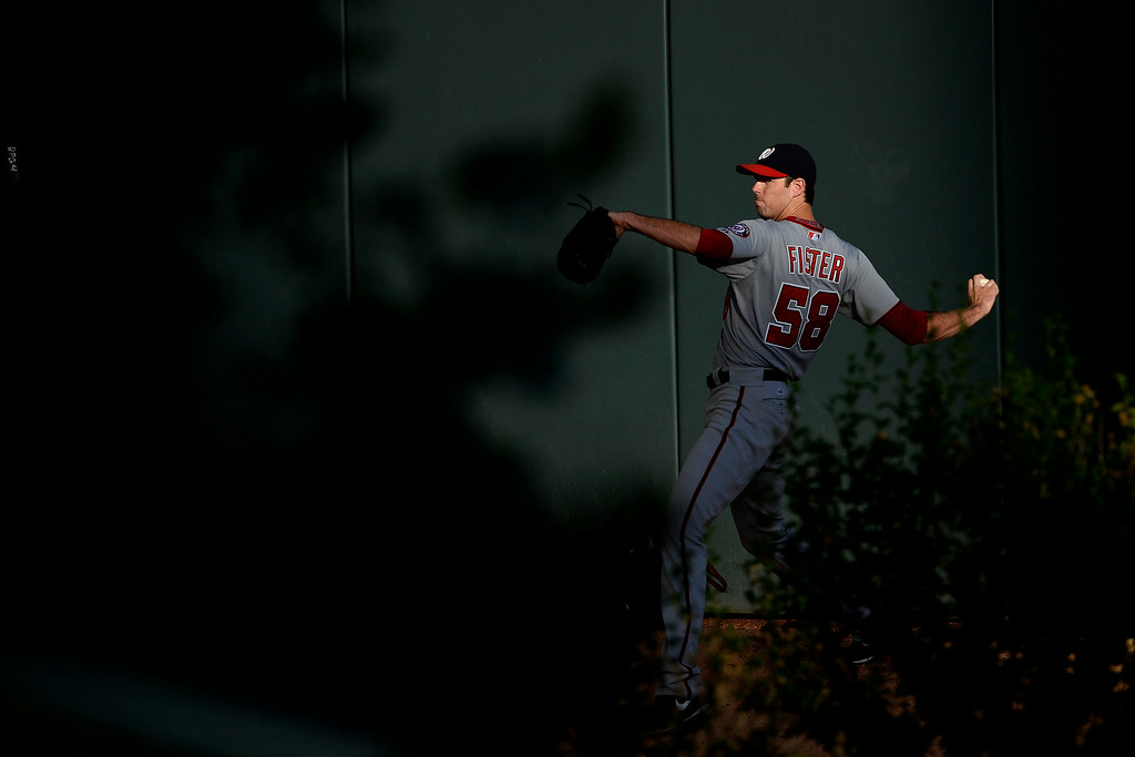 . Doug Fister (58) of the Washington Nationals warms up in the bullpen before the action started at Coors Field. Major League Baseball action between the Colorado Rockies and the Washington Nationals on Monday, July 21, 2014. (Photo by AAron Ontiveroz/The Denver Post)