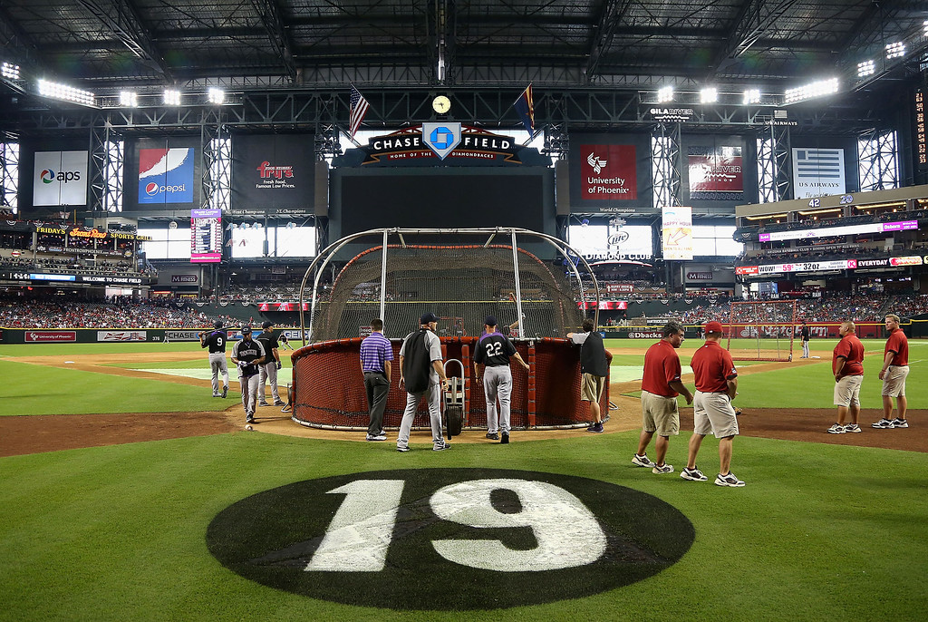 """. PHOENIX, AZ - JULY 05:  A \""""19\"""" is painted on the field in honor of the 19 Granite Mountain Interagency Hotshot Crew firefighters who died battling a fast-moving wildfire near Yarnell, AZ before the MLB game between the Arizona Diamondbacks and Colorado Rockies  at Chase Field on July 5, 2013 in Phoenix, Arizona.  (Photo by Christian Petersen/Getty Images)"""