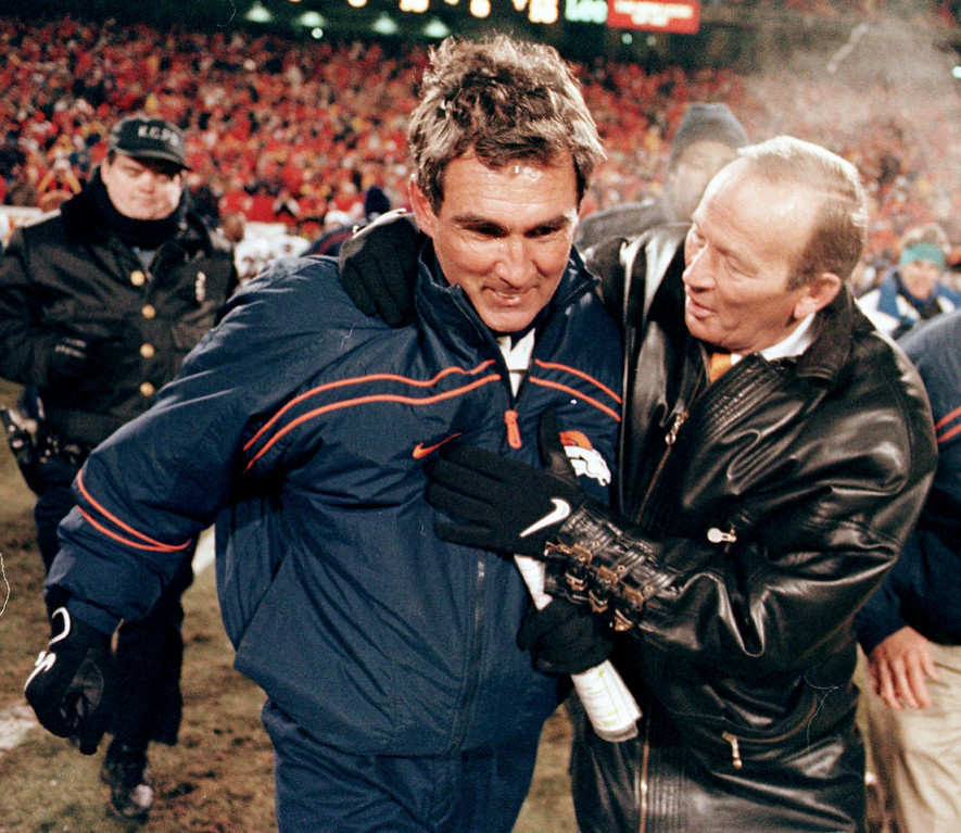 . Denver Broncos owner Pat Bowlen congratulates head coach  Mike Shanahan after the Broncos defeated the Kansas City Chiefs  14-10 in 1998.  Karl Gehring, The Denver Post