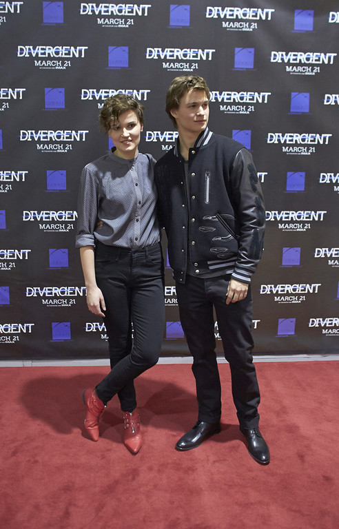 ". ""Divergent\"" author Veronica Roth and actor Ansel Elgort attend the \""Divergent\"" screening at the Mall of America on March 5, 2014 in Bloomington, Minnesota. (Photo by Adam Bettcher/Getty Images)"