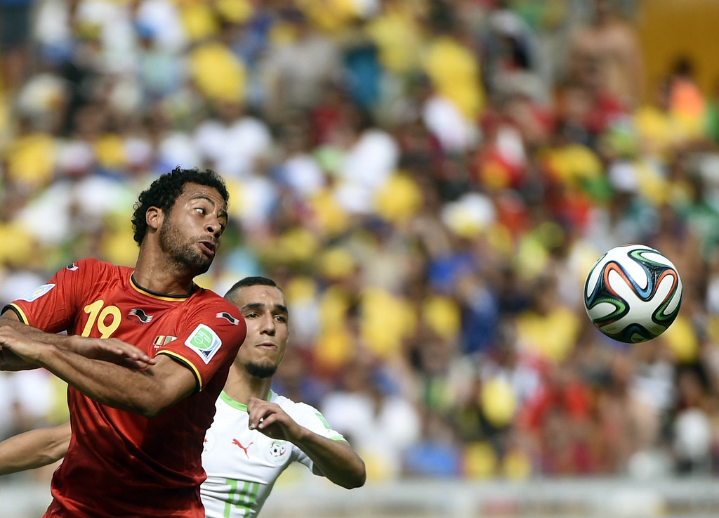 . Belgium\'s midfielder Moussa Dembele (L) and Algeria\'s midfielder Nabil Bentaleb vie for the ball during a Group H football match between Belgium and Algeria at the Mineirao Stadium in Belo Horizonte during the 2014 FIFA World Cup on June 17, 2014. MARTIN BUREAU/AFP/Getty Images