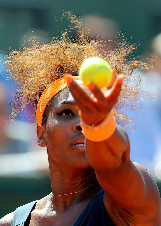 . Serena Williams, of the U.S, serves the ball to Russia\'s Svetlana Kuznetsova during their quarterfinal match of the French Open tennis tournament at the Roland Garros stadium Tuesday, June 4, 2013 in Paris. Williams won 6-1, 3-6, 6-3. (AP Photo/Michel Euler)