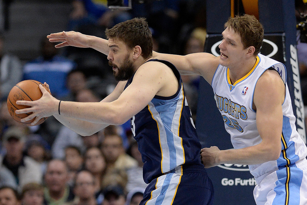 . Memphis Grizzlies center Marc Gasol (33) grabs a rebound from Denver Nuggets center Timofey Mozgov (25) during the third quarter of action. (Photo by AAron Ontiveroz/The Denver Post)