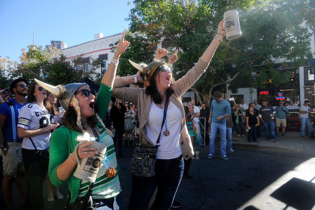 . DENVER, CO: Sept 28, 2013  Patty Webster and Sherry Shibly cheer on a contestant in the Stein Hoisting competition. The pair spent the afternoon at Denver\'s Oktoberfest and even bought viking hats and made pretzel necklaces for the occasion.   (Photo By Erin Hull/The Denver Post)