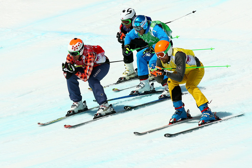 . (L-R) Christopher Delbosco of Canada (red bib), Didrik Bastian Juell of Norway (blue bib), Thomas Zangerl of Austria (green bib) and Andreas Schauer of Germany (yelllow bib) compete during the Freestyle Skiing Men\'s Ski Cross 1/8 Finals on day 13 of the 2014 Sochi Winter Olympic at Rosa Khutor Extreme Park on February 20, 2014 in Sochi, Russia.  (Photo by Cameron Spencer/Getty Images)