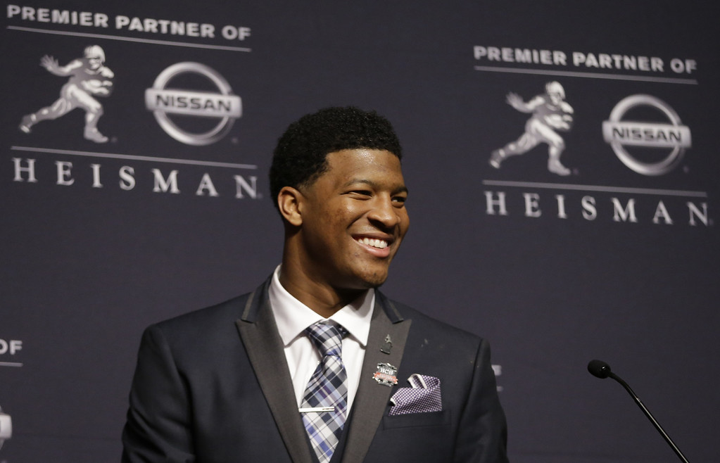 . Florida State quarterback Jameis Winston talks to reporters after winning the Heisman Trophy, Saturday, Dec. 14, 2013, in New York. (AP Photo/Julio Cortez)