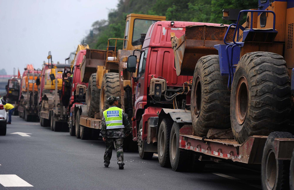 . This photo taken on April 21, 2013 shows trucks transporting escavators into the disaster-hit area in Ya\'an, southwest China\'s Sichuan province.   STR/AFP/Getty Images