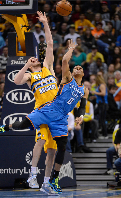 . DENVER, CO. - JANUARY 20: Oklahoma City Thunder point guard Russell Westbrook (0) takes an off ballnce shot over Denver Nuggets center Kosta Koufos (41) during the second quarter January 20,  2013 at Pepsi Center. Denver Nuggets center Kosta Koufos (41) was called for a foul on the play. (Photo By John Leyba / The Denver Post)