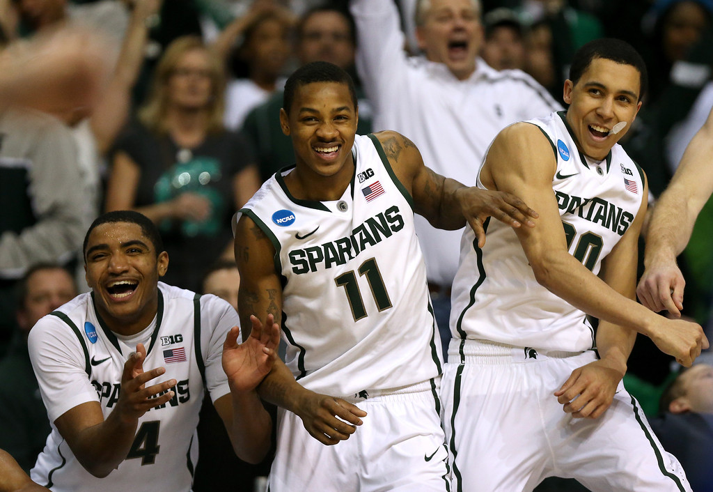 . AUBURN HILLS, MI - MARCH 23:  (L-R) Gary Harris #14, Keith Appling #11 and Travis Trice #20 of the Michigan State Spartans celebrate on the bench against the Memphis Tigers during the third round of the 2013 NCAA Men\'s Basketball Tournament at The Palace of Auburn Hills on March 23, 2013 in Auburn Hills, Michigan.  (Photo by Jonathan Daniel/Getty Images)