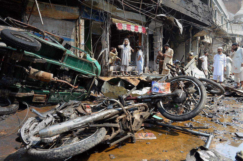 . Pakistani shop onwers gather at the site of a bomb explosion in the busy Kissa Khwani market in Peshawar on September 29, 2013. AFP PHOTO /  A. MAJEED/AFP/Getty Images