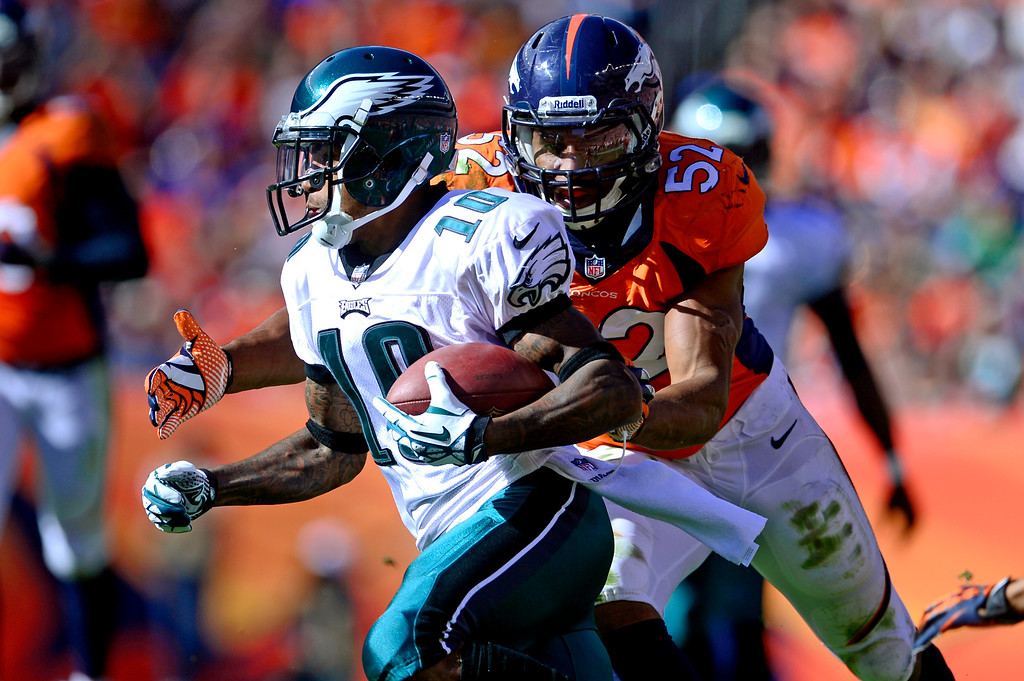 . Denver Broncos outside linebacker Wesley Woodyard (52) wraps up Philadelphia Eagles wide receiver DeSean Jackson (10) during the second quarter.  (Photo by AAron Ontiveroz/The Denver Post)