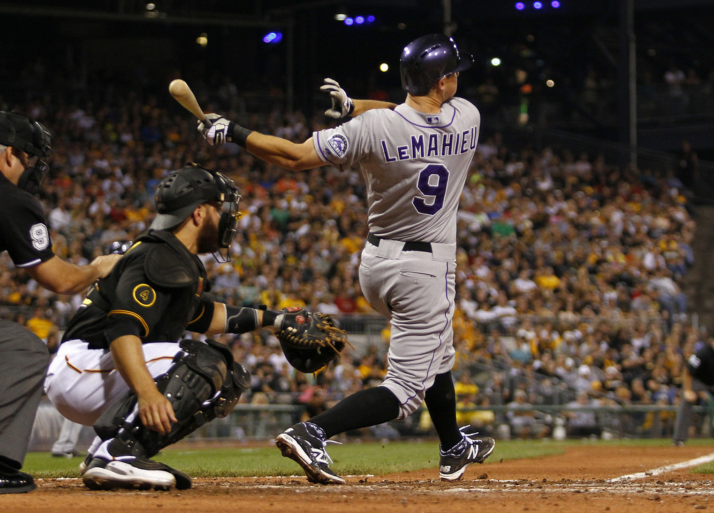 . PITTSBURGH, PA - JULY 18:  Vinny Castilla #9 of the Colorado Rockies hits a RBI single in the sixth inning against the Pittsburgh Pirates during the game at PNC Park July 18, 2014 in Pittsburgh, Pennsylvania.  (Photo by Justin K. Aller/Getty Images)