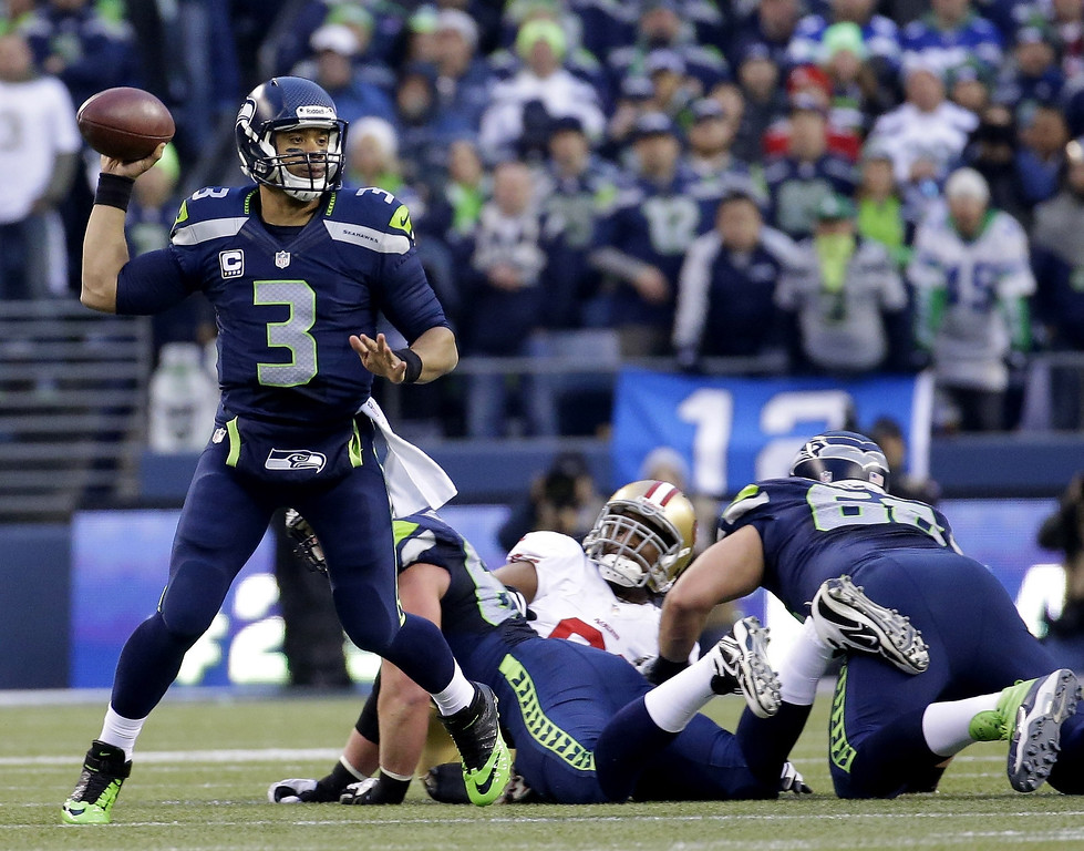 . Seattle Seahawks\' Russell Wilson throws during the first half of the NFL football NFC Championship game against the San Francisco 49ers Sunday, Jan. 19, 2014, in Seattle. (AP Photo/Ted S. Warren)