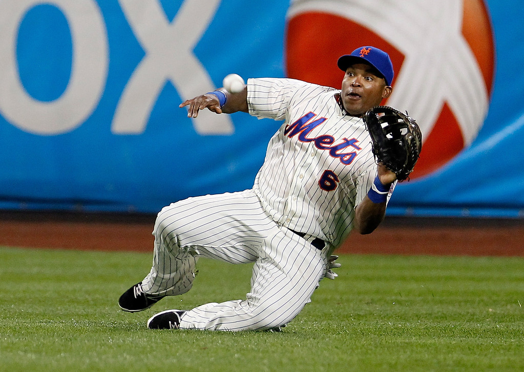 . Marlon Byrd #6 of the New York Mets makes a sliding catch off the bat of Troy Tulowitzki #2 of the Colorado Rockies in the eighth inning at Citi Field on August 6, 2013 at Citi Field in the Flushing neighborhood of the Queens borough of New York City. Mets defeated the Rockies 3-2. (Photo by Mike Stobe/Getty Images)