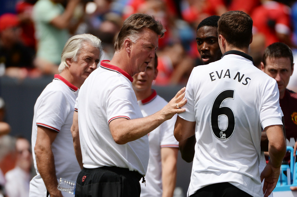 . Manchester United manager Louis van Gaal, left, is talking to Jonny Evans (6) during the game against AS Roma at Sports Authority Field at Mile High in Denver, Colorado, July 26, 2014. (Photo by Hyoung Chang/The Denver Post)