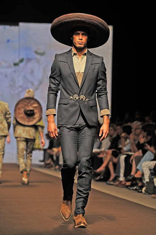 . A model walks the runway at the Etro show during Milan Menswear Fashion Week Spring Summer 2014 show on June 24, 2013 in Milan, Italy.  (Photo by Stefania D\'Alessandro/Getty Images)