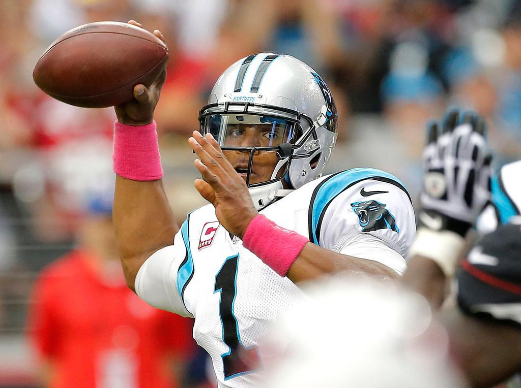 . Carolina Panthers quarterback Cam Newton (1) throws against the Arizona Cardinals during the first half of an NFL football game, Sunday, Oct. 6, 2013, in Glendale, Ariz. (AP Photo/Matt York)