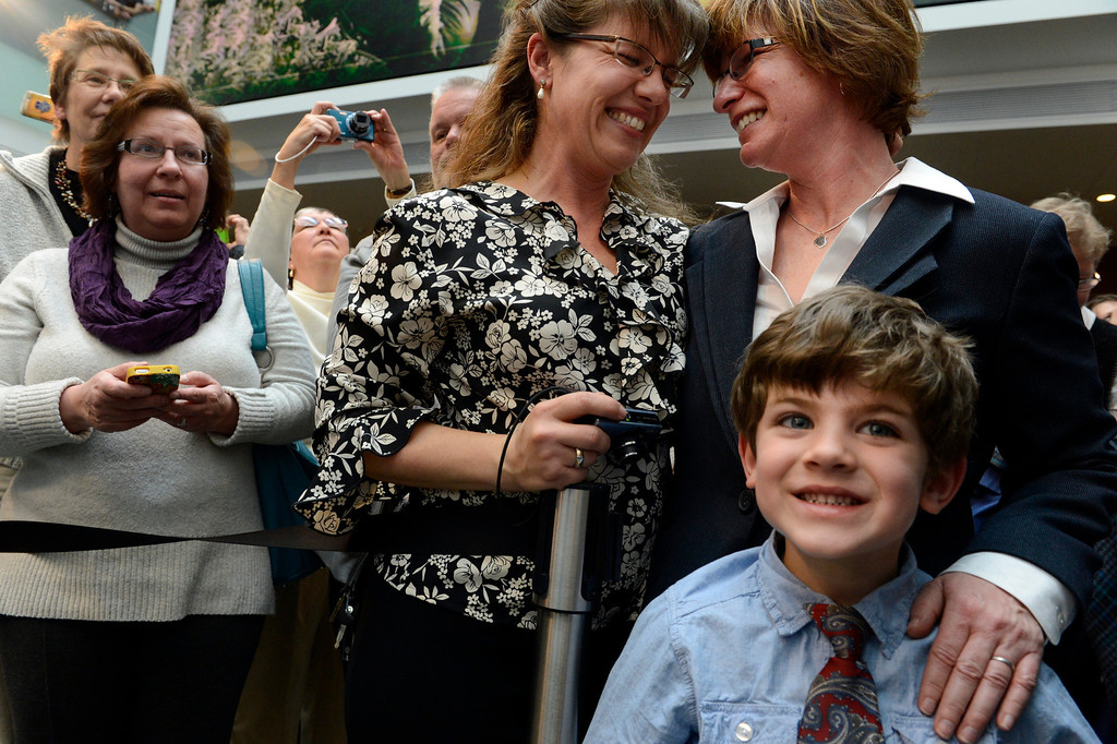. DENVER, CO. - MARCH 21: Fran and Anna Simon and their son Jeremy, 5, share a moment  after Gov. John Hickenlooper signed the Colorado Civil Union Act at the History Colorado Center in  Denver, CO March 21, 2013. The couple has been together 10 years and plans to be joined in civil union on May 1, 2013. Colorado one of 18 states that offer recognition of same-sex couples, either through marriage or civil unions, according to the state\'s largest gay-rights group, One Colorado. The bill was sponsored by four openly gay lawmakers, Senators Pat Steadman and Lucia Guzman, Representative Sue Schafer, and Speaker Mark Ferrandino. (Photo By Craig F. Walker/The Denver Post)