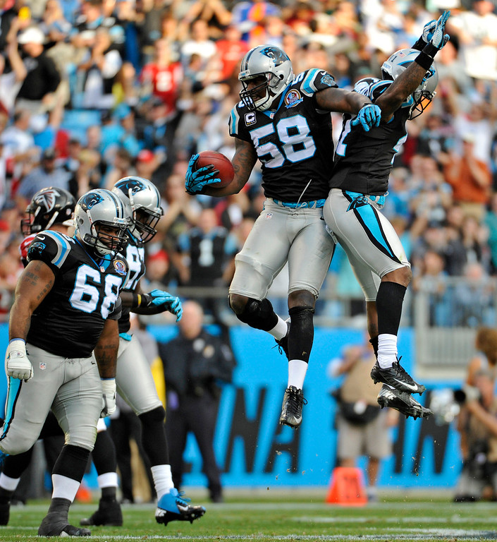. Carolina Panthers\' Thomas Davis (58) celebrates with Captain Munnerlyn (41) after intercepting an Atlanta Falcons pass during the second half of an NFL football game in Charlotte, N.C., Sunday, Dec. 9, 2012. (AP Photo/Rainier Ehrhardt)