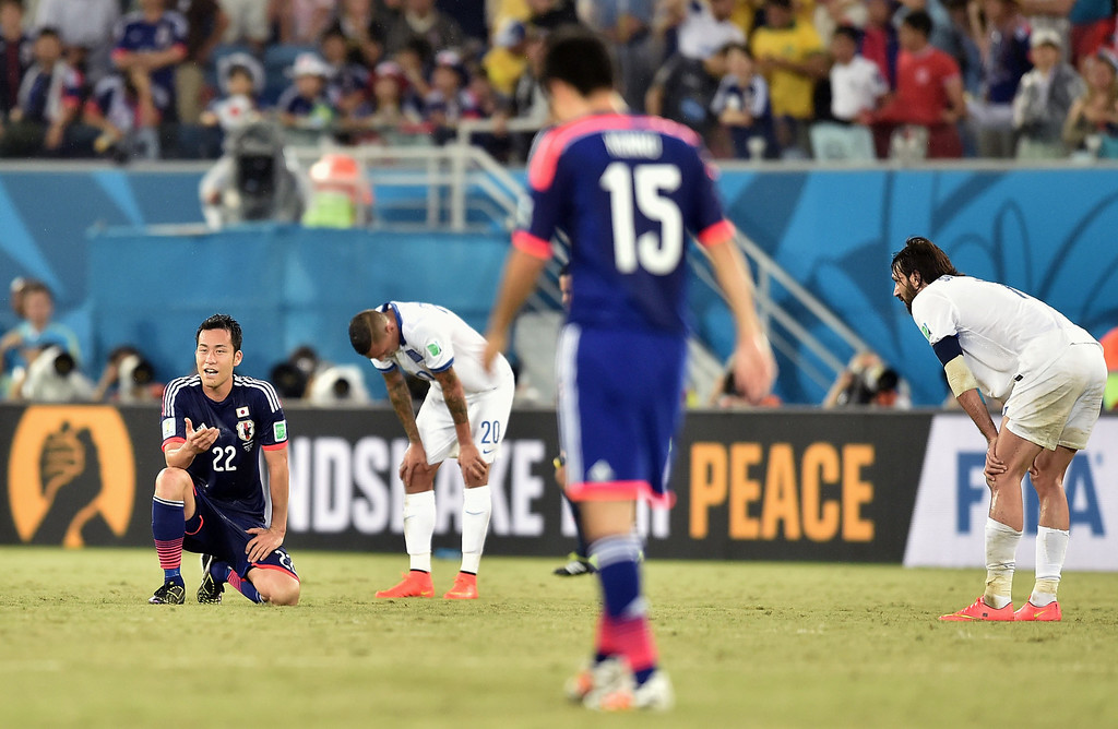 . Japan\'s defender Maya Yoshida, (L) and Greece\'s defender Jose Holebas (2nd L) Japan\'s defender Yasuyuki Konno (2nd R) and Greece\'s forward Georgios Samaras (R) are pictured following a 0-0 score during a Group C match between Japan and Greece at the Dunas Arena in Natal during the 2014 FIFA World Cup on June 19, 2014.  ARIS MESSINIS/AFP/Getty Images