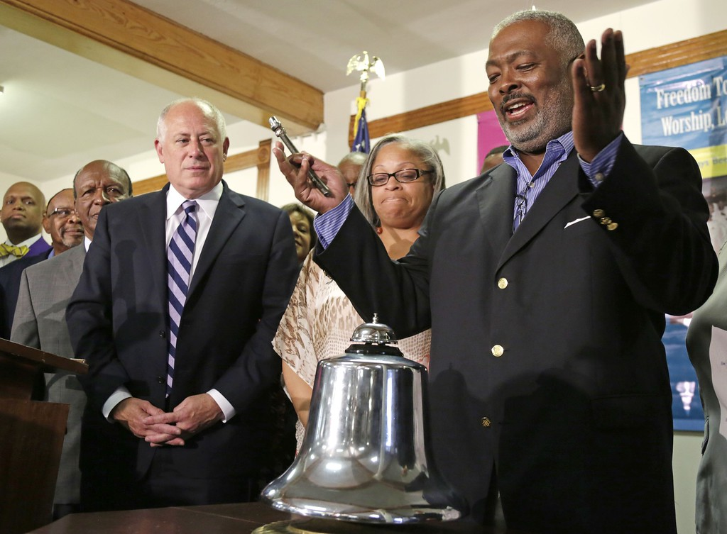 ". Illinois Gov. Pat Quinn left, and Chicago Alderman Deborah Graham, watch as Rev. James Moody finishes ringing a bell at 3:00 PM eastern time to commemorate the 50th anniversary of Dr. Martin Luther King\'s ""I Have a Dream\"" speech at Quinn Chapel AME Church Wednesday, Aug. 28, 2013, in Chicago. King gave his famous speech 50 years ago today during the march on Washington. Quinn Chapel AME Church is Illinois\' oldest African American congregation and King once spoke from the pulpit there. (AP Photo/M. Spencer Green)"