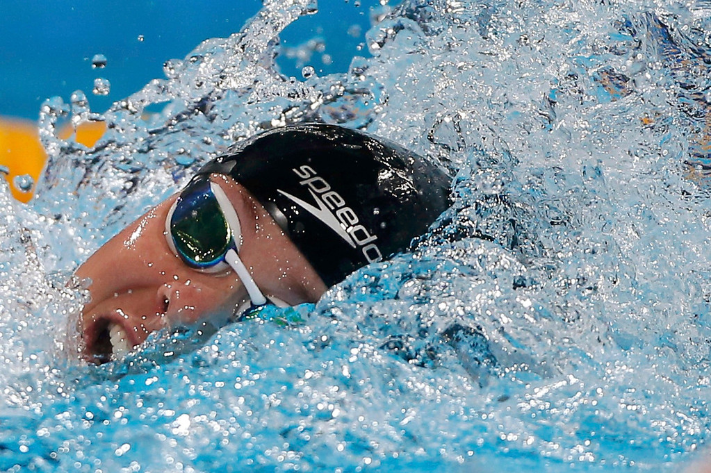 . Katie Ledecky of the U.S. swims to win the women\'s 800m freestyle final during the World Swimming Championships at the Sant Jordi arena in Barcelona August 3, 2013. The 16-year-old clocked a time of eight minutes 13.86 seconds to set a world record to win the event on Saturday and complete a rare treble of distance titles.   REUTERS/Albert Gea