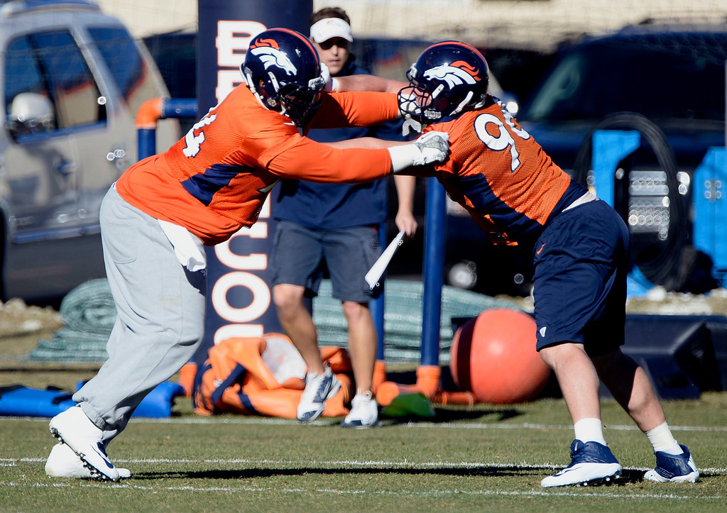 . Denver Broncos defensive tackle Terrance Knighton (94) and Denver Broncos defensive tackle Mitch Unrein (96) work on drills during practice November 27, 2013 at Dove Valley (Photo by John Leyba/The Denver Post)